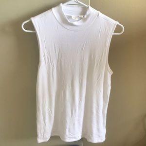 White, low neck sleeveless knit top.